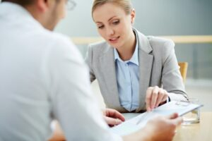 Woman consultant explaining contract to her client